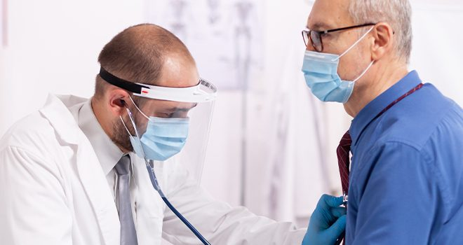 Doctor checking for heart problems from covid image
